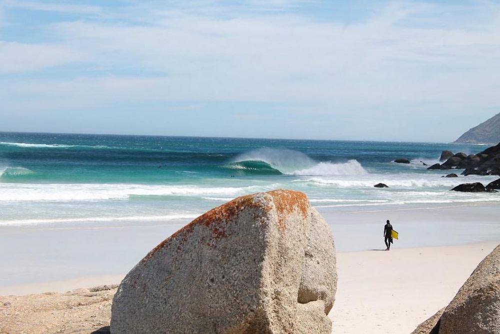 Person walking on beach near surf resort